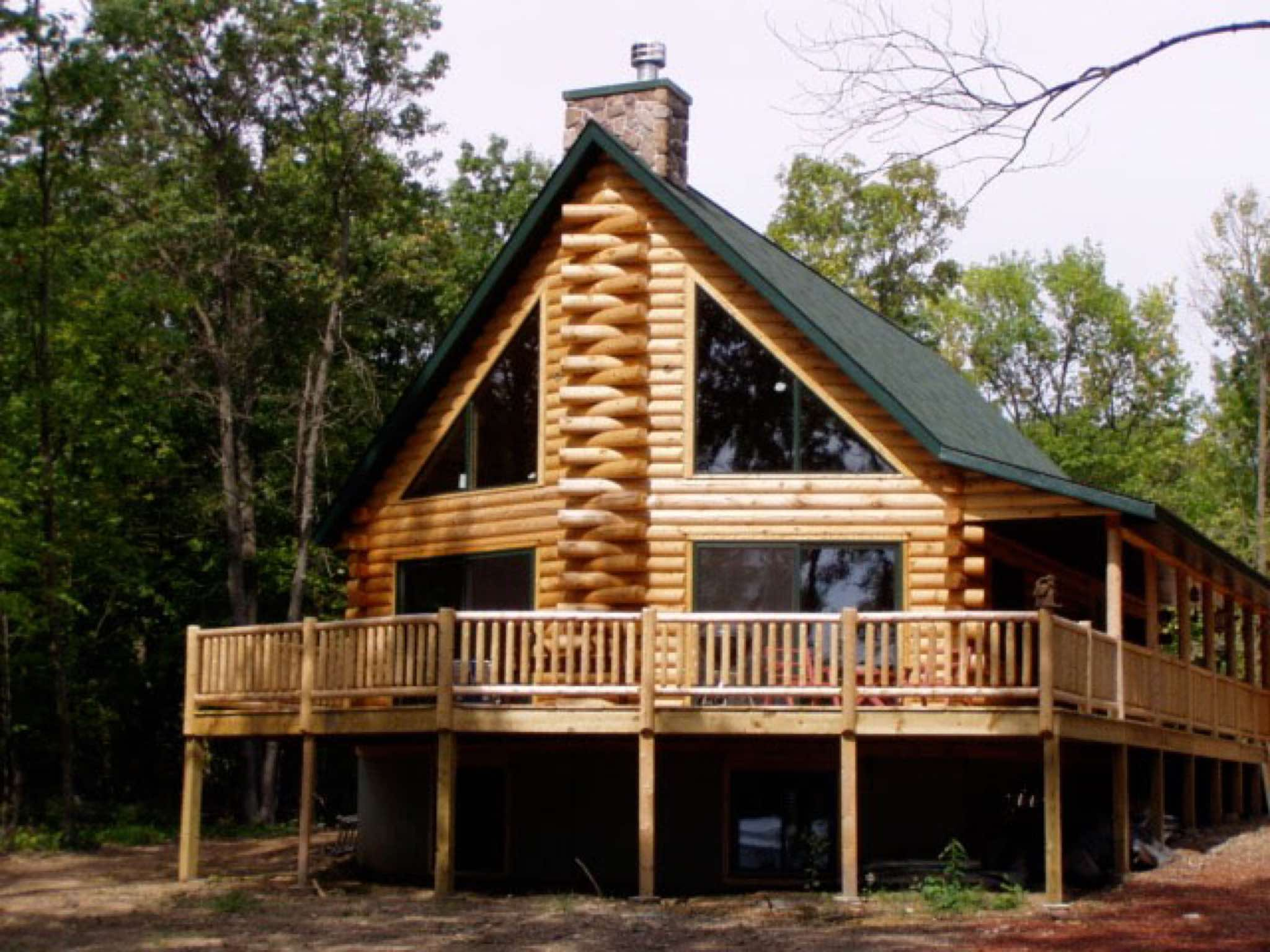 Minnesota and wisconsin log cabin builders for Building a house in wisconsin