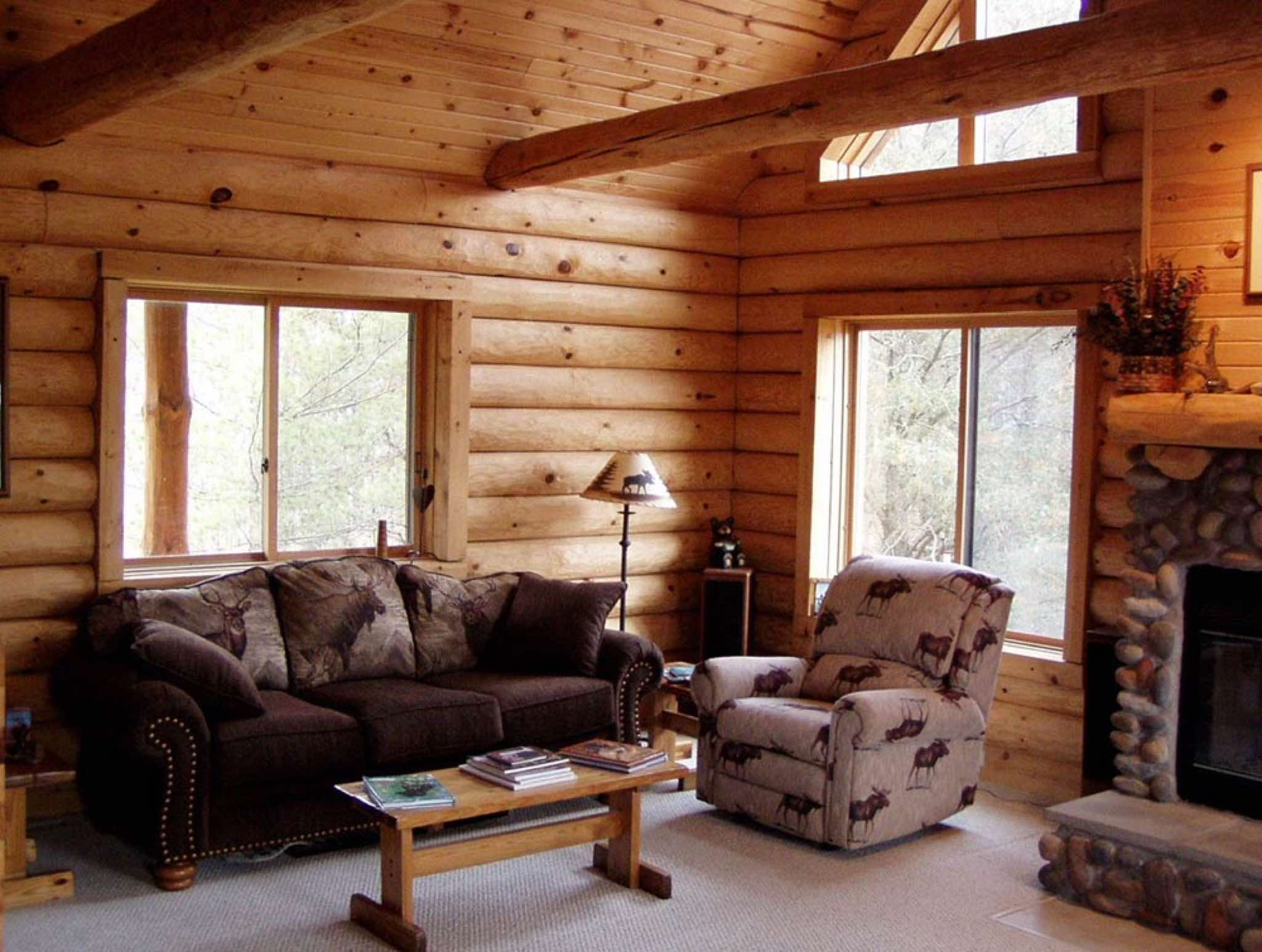 minnesota and wisconsin log cabin builders rustic hand peeled half log on the interior